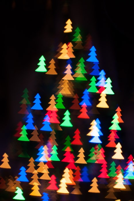 Kerstkaart met figuurtjes bokeh