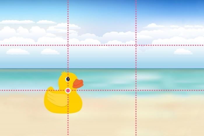 Interessante elementen van de foto (in dit geval: het badeendje) plaat je onder de snijpunten van de lijnen van derden.